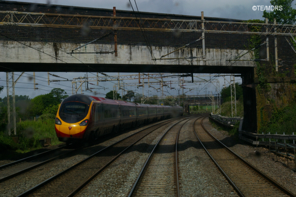 Pendolino speeding past the Bletchley train