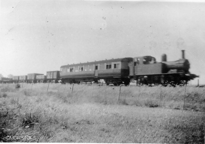 1411 at Spade Oak with a mixed train'